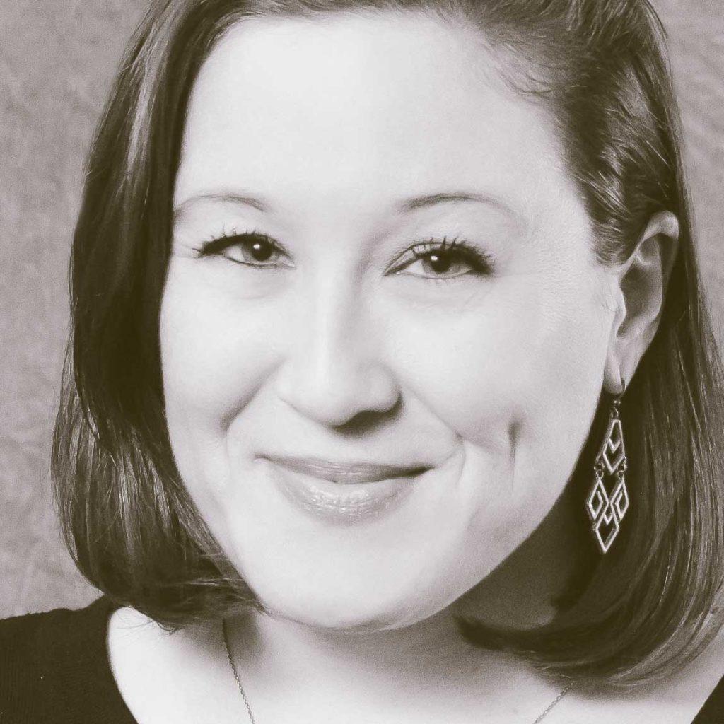 woman headshot with dangling earring